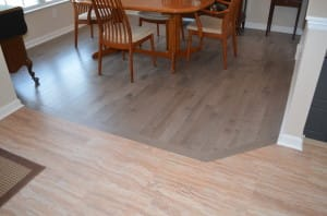 Solid hardwood, prefinished in grey